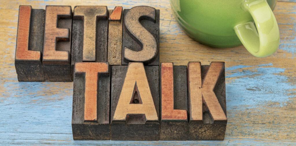 Let's Talk blocks on desk